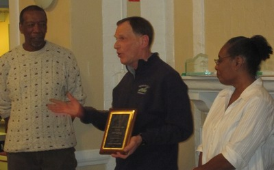 Bob Gaylord receiving the James Moore award from James (left) and Rebecca (right)