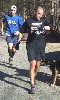 Sean Andrish leads Mike Schuster to the finish line