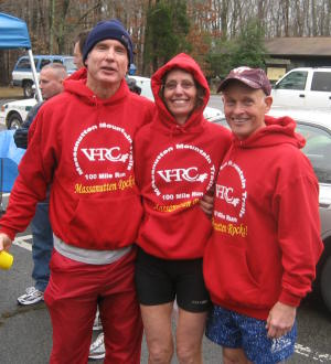 Anstr, Vicki, and Gary are in uniform at post run festivities