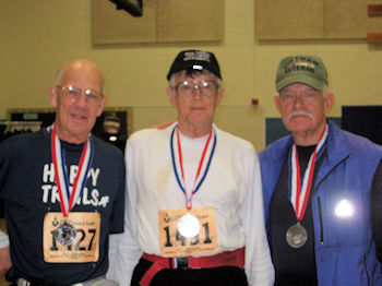 Paul, right, with Ed Demoney and Art Moore at the 2009 JFK finish