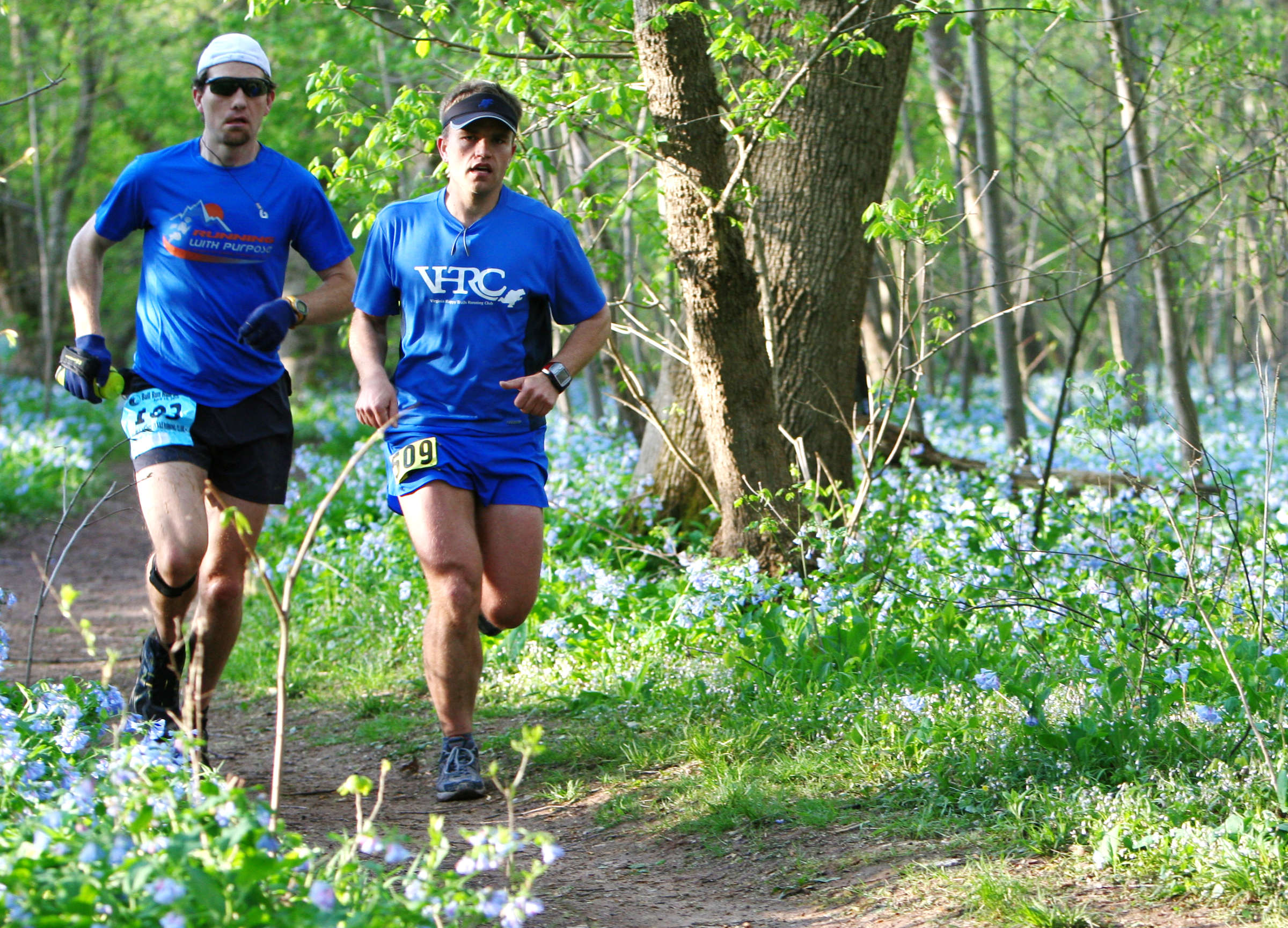 Brad Hinton and Keith Knipling cruise through the bluebells during the early miles of the 2010 BRR.