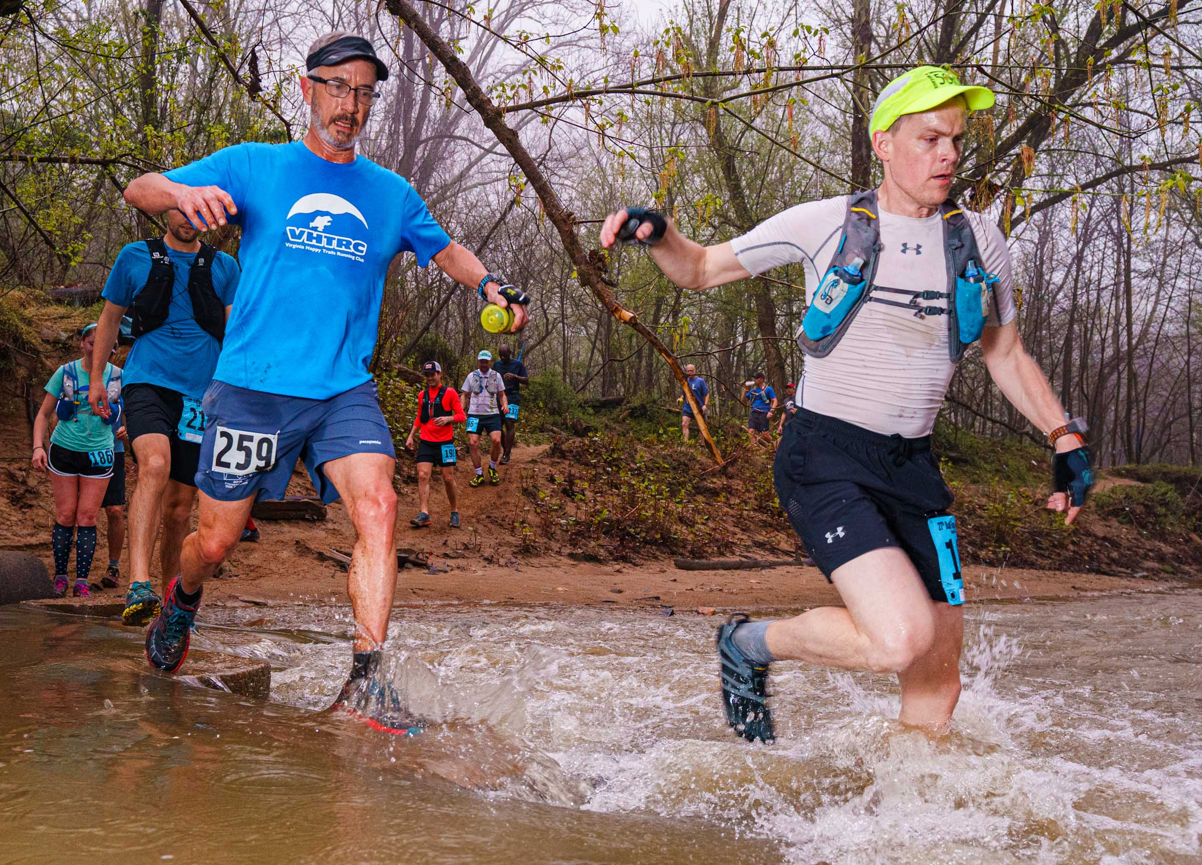 Runners crossing Popes Head Creek during the early miles of the 2019 BRR