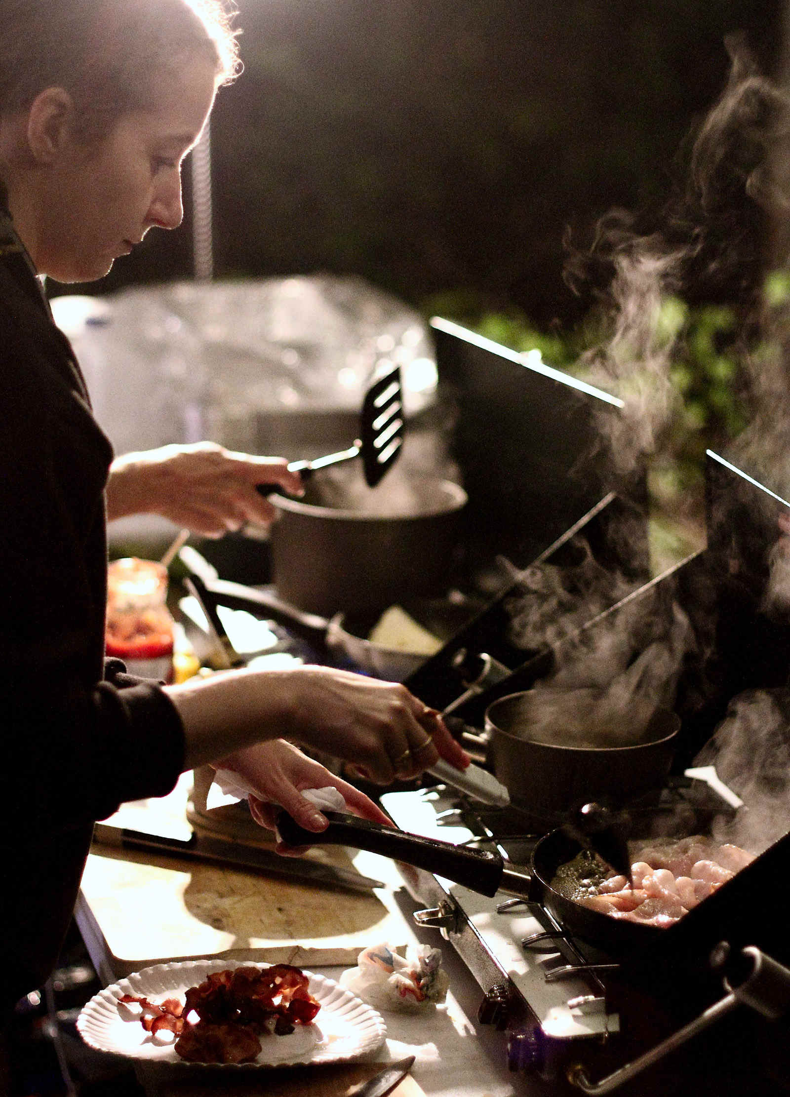 Volunteer Samantha Neakrase cooks breakfast at an aid station during the 2015 MMT 100