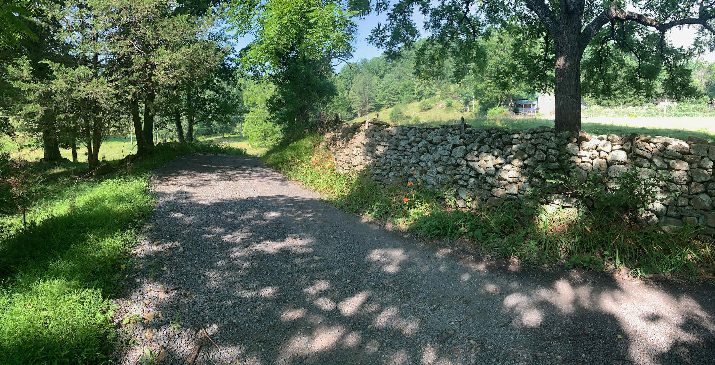 Passing old homesteads and stone walls along Rolling Road